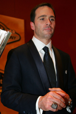 LAS VEGAS - DECEMBER 04:  Four time NASCAR Sprint Cup Series Champion Jimmie Johnson poses next to his trophy after the NASCAR Sprint Cup Series awards banquet during the final day of the NASCAR Sprint Cup Series Champions Week on December 4, 2009 in Las