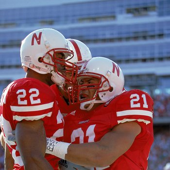 6 Nov 1999:  Mike Brown #21 of the Nebraska Cornhuskers celebrates with teammates Ralph Brown II #22 during the game against the Texas A&M Aggies at the Memorial Stadium in Lincoln, Nebraska. The Cornhuskers defeated the Aggies 37-0. Mandatory Credit: Bri