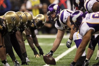NEW ORLEANS - JANUARY 24:  Offensive center John Sullivan #65 of the Minnesota Vikings looks down the line of scrimmage as he gets set to snap the ball against the New Orleans Saints during the NFC Championship Game at the Louisiana Superdome on January 2