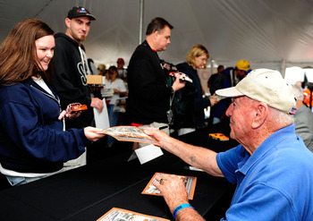 DARLINGTON, SC - SEPTEMBER 26:  NASCAR legend Marvin Panch signs autographs during the Darlington Historic Racing Festival on September 26, 2009 at Darlington Raceway in Darlington, South Carolina.  (Photo by Rusty Jarrett/Getty Images)