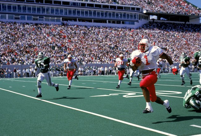 9 Nov 1995: Lawrence Phillips #1 of the Nebraska Cornhuskers carries the ball during a game against the Michigan State Spartans at the Spartan Stadium in East Lansing, Michigan. The Cornhuskers defeated the Spartans 50-10. Mandatory Credit: Jonathan Danie