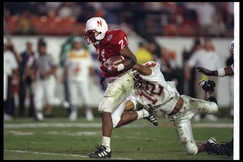 31 Dec 1996:  Running back Damon Benning of the Nebraska Cornhuskers attempts to break the tackle of Virginia Tech Hokies defensive back Loren Johnson during the Orange Bowl at the Orange Bowl in Miami, Florida.  Nebraska won the game, 41-21. Mandatory Cr