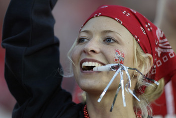 3 Jan 2002:  A Nebraska fan cheers for the team during the Rose Bowl National Championship game against Miami at the Rose Bowl in Pasadena, California.  Miami won the game 37-14, winning the BCS and the National Championship title. DIGITAL IMAGE. Mandator