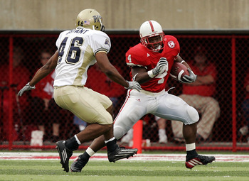 LINCOLN, NE - SEPTEMBER 17:  Running back Corey Ross #4 of the Nebraska Cornhuskers dodges Sam Bryant #46 of the Pittsburgh Panthers on September 17, 2005 at Memorial Stadium in Lincoln, Nebraska.  Nebraska won 7-6.  (Photo by Brian Bahr/Getty Images)