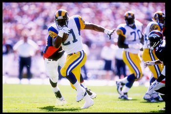 14 Sep 1997:  Running back Lawrence Phillips #21 of the St Louis Rams in action during a game against the Denver Broncos at Mile High Stadium in Denver, Colorado.  The Broncos won the game 35-14.  Mandatory Credit: Brian Bahr  /Allsport