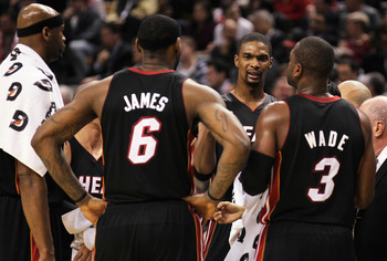 TORONTO, CANADA - FEBRUARY 16:  Chris Bosh #1 of the Miami Heat talks to teammates LeBron James #6 and Dwyane Wade #3 during a timeout in a game against the Toronto Raptors on February 16, 2011 at the Air Canada Centre in Toronto, Canada. The Heat defeate