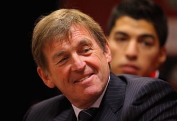 LIVERPOOL, ENGLAND - FEBRUARY 03:  Kenny Dalglish the manager of Liverpool and new signing Luis Suarez look on as they face the media during a press conference at Anfield on February 3, 2011 in Liverpool, England.  (Photo by Alex Livesey/Getty Images)