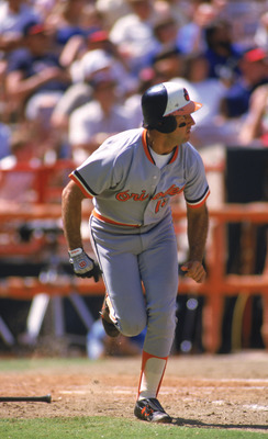 ANAHEIM, CA - SEPTEMBER:  Fred Lynn #19 of the Baltimore Orioles runs to first base against the California Angels during a September 1986 game at Anaheim Stadium in Anaheim, California.  (Photo by Rick Stewart/Getty Images)