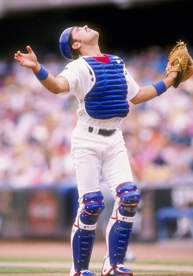 25 Jul 1993:  Catcher Mike Piazza of the Los Angeles Dodgers looks to catch the ball during a game against the New York Mets at Dodger Stadium in Los Angeles, California. Mandatory Credit: Stephen Dunn  /Allsport
