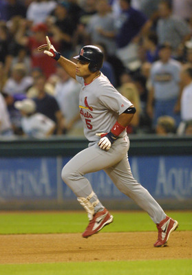 10 Oct 2001:  Albert Pujols of the St. Louis Cardinals celebrates after hitting a home run against Randy Johnson of the Arizona Diamondbacks during Game 2 of the National League Western Divisional Series at Bank One Ballpark in Phoenix, Arizona. DIGITAL I