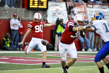 LINCOLN, NEBRASKA - SEPTEMBER 25: Nebraska Cornhuskers kicker Alex Henery #90 punts the ball away during first half action of their game at Memorial Stadium on September 25, 2010 in Lincoln, Nebraska. Nebraska Defeated South Dakota State 17-3. (Photo by E