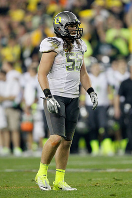 GLENDALE, AZ - JANUARY 10:  Casey Matthews #55 of the Oregon Ducks looks on against the Auburn Tigers during the Tostitos BCS National Championship Game at University of Phoenix Stadium on January 10, 2011 in Glendale, Arizona.  (Photo by Kevin C. Cox/Get