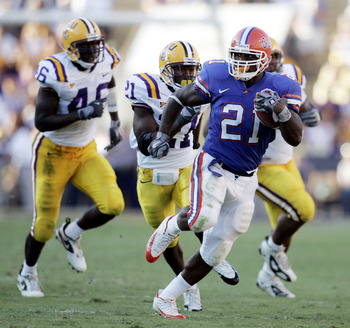 BATON ROUGE, LA - OCTOBER 15:  DeShawn Wynn #21 of the University of Florida is chased by members of the Louisiana State University defense at Tiger Stadium in Baton Rouge, Louisiana on October 15, 2005. LSU defeated the University of Florida 21-17.  (Pho
