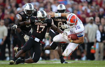 COLUMBIA, SC - NOVEMBER 14:  Tim Tebow #15 of the Florida Gators is tackled by Chris Culliver #17 of the South Carolina Gamecocks during their game at Williams-Brice Stadium on November 14, 2009 in Columbia, South Carolina.  (Photo by Streeter Lecka/Getty