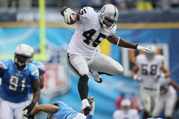 SAN DIEGO - DECEMBER 05:  Fullback Marcel Reece #45 of the Oakland Raiders leaps over Eric Weddle (not pictured) #32 of the San Diego Chargers in the second quarter at Qualcomm Stadium on December 5, 2010 in San Diego, California. The Raiders defeated the