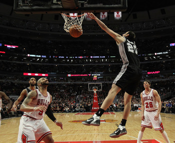 CHICAGO, IL - FEBRUARY 17: Manu Ginobili #20 of the San Antonio Spurs dunks the ball over Carlos Boozer #5 of the Chicago Bulls at the United Center on February 17, 2011 in Chicago, Illinois. The Bulls defeated the Spurs 109-99. NOTE TO USER: User express