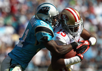 CHARLOTTE, NC - OCTOBER 24:  Michael Crabtree #15 of the San Francisco 49ers is tackled by Richard Marshall #31 of the Carolina Panthers during their game at Bank of America Stadium on October 24, 2010 in Charlotte, North Carolina.  (Photo by Streeter Lec