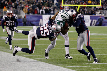 Patrick Chung (25) & Brandon Meriweather (31) tackling Braylon Edwards