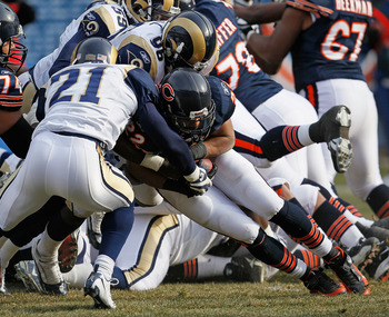 Atogwe (#21) tackling Bears RB Matt Forte