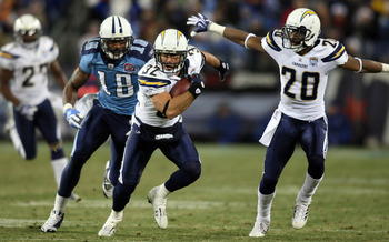 Eric Weddle (32) and Antoine Cason (20) trying to run away from Kenny Britt