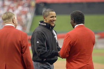 ST LOUIS, MO - JULY 14: U.S. President Barack Obama greets Hall of Famer Lou Brock after throwing out the first pitch at the 2009 MLB All-Star Game at Busch Stadium on July 14, 2009 in St Louis, Missouri. (Photo by Pool/Getty Images)