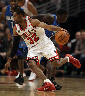 CHICAGO, IL - JANUARY 28: C.J. Watson #32 of the Chicago Bulls moves against the Orlando Magic as teammate Derrick Rose watches at the United Center on January 28, 2011 in Chicago, Illinois. The Bulls defeated the Magic 99-90. NOTE TO USER: User expressly