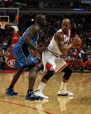 CHICAGO, IL - JANUARY 28: Keith Bogans #6 of the Chicago Bulls prepares to move against Jason Richardson #23 of the Orlando Magic at the United Center on January 28, 2011 in Chicago, Illinois. The Bulls defeated the Magic 99-90. NOTE TO USER: User express