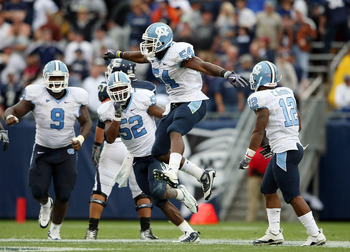 EAST HARTFORD, CT - SEPTEMBER 12:  Bruce Carter #54 of the North Carolinia Tar Heels celebrates his sack with teammates Melvin Williams #10, Marvin Austin #9 and Quan Sturdivant #52 in the final minute of the game against the Connecticut Huskies on Septem