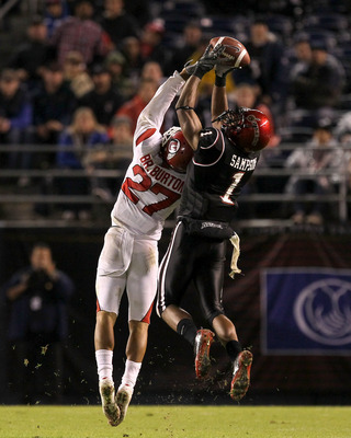 SAN DIEGO - NOVEMBER 20:  Wide receiver DeMarco Sampson #1 of the San Diego State Aztecs makes a catch over cornerback Brandon Burton #27 of the Utah Utes at Qualcomm Stadium on November 20, 2010 in San Diego, California.  Utah won 38-34.  (Photo by Steph