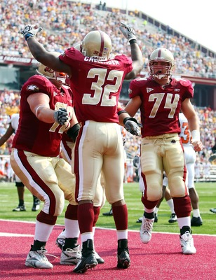 CHESTNUT HILL, MA - OCTOBER 06:  Andre Callender #32 of the Boston College Eagles is congratulated by teammates Anthony Castonzo #74 and Ty Hall #78 after Callender scored touchdown in the second quarter against the Bowling Green Falcons  on October 6, 20