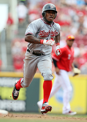 CINCINNATI - JULY 22:  Willie Harris #22 of the Washington Nationals runs to third base during the game against the Cincinnati Reds at Great American Ball Park on July 22, 2010 in Cincinnati, Ohio.  (Photo by Andy Lyons/Getty Images)