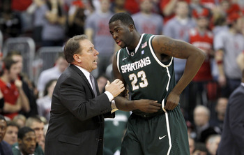 COLUMBUS, OH - FEBRUARY 15:  Head Coach Tom Izzo speaks with Draymond Green #23, both of the Michigan State Spartans, during the first half against the Ohio State Buckeyes on February 15, 2011 at Value City Arena in Columbus, Ohio.  (Photo by Gregory Sham