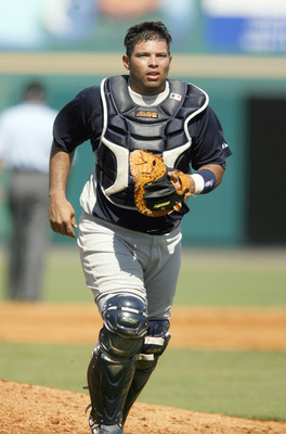 BRADENTON, FL - MARCH 10:  Catcher Raul Chavez #59 of the New York Yankees jogs on the field against the Pittsburgh Pirates during a Spring Training game on March 10, 2007 at McKechnie Field in Bradenton, Florida. New York won the game 5-3. (Photo By Greg