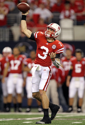 ARLINGTON, TX - DECEMBER 04:  Quarterback Taylor Martinez #3 of the Nebraska Cornhuskers drops back to pass against the Oklahoma Sooners during the Big 12 Championship at Cowboys Stadium on December 4, 2010 in Arlington, Texas.  (Photo by Ronald Martinez/