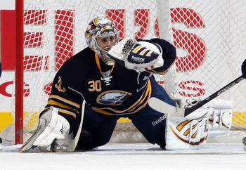 UNIONDALE, NY - JANUARY 23: Ryan Miller #30 of the Buffalo Sabres makes the save against the New York Islanders at the Nassau Coliseum on January 23, 2011 in Uniondale, New York.  (Photo by Bruce Bennett/Getty Images)