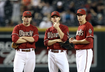 PHOENIX - SEPTEMBER 22:  Inifleders Mark Reynolds #27, Stephen Drew #6 and Kelly Johnson #2 of the Arizona Diamondbacks during the Major League Baseball game against the Colorado Rockies at Chase Field on September 22, 2010 in Phoenix, Arizona.  (Photo by