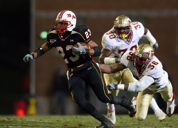COLLEGE PARK, MD - NOVEMBER 22: DaRel Scott #23 of the Maryland Terrapins runs the ball past Dekoda Watson #36 and Derek Nicholson #30 of the Florida State Seminoles on November 22, 2008 at Byrd Stadium in College Park, Maryland.  (Photo by Jim McIsaac/Ge