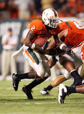 FORT LAUDERDALE, FL - SEPTEMBER 17: Running back Graig Cooper #2 of the Miami Hurricanes looks for room to run while taking on the Georgia Tech Yellow Jackets at Land Shark Stadium on September 17, 2009 in Fort Lauderdale, Florida. Miami defeated Georgia