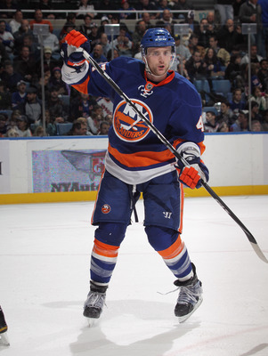 UNIONDALE, NY - DECEMBER 02:  Mark Eaton #4 of the New York Islanders skates against the New York Rangers at the Nassau Coliseum on December 2, 2010 in Uniondale, New York.  (Photo by Bruce Bennett/Getty Images)