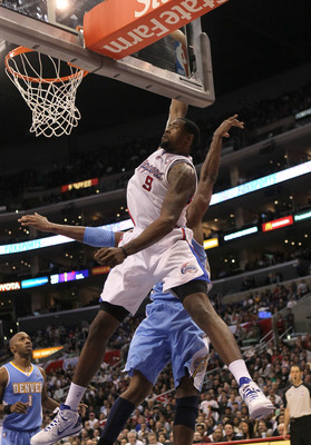 LOS ANGELES, CA - JANUARY 5:  DeAndre Jordan #9 of the Los Angeles Clippers makes an alley oop dunk against the Denver Nuggets at Staples Center on January 5, 2011  in Los Angeles, California. The Clippers won 106-93.  NOTE TO USER: User expressly acknowl