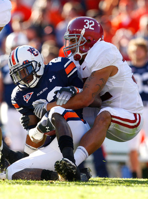 AUBURN, AL - NOVEMBER 27:  Eryk Anders #32 of the Alabama Crimson Tide tackles Onterio McCalebb #23 of the Auburn Tigers at Jordan-Hare Stadium on November 27, 2009 in Auburn, Alabama.  (Photo by Kevin C. Cox/Getty Images)