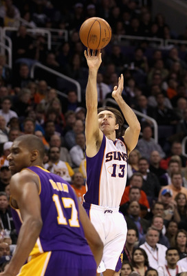 PHOENIX - JANUARY 05: Steve Nash #13 of the Phoenix Suns puts up a shot over Andrew Bynum #17 of the Los Angeles Lakers during the NBA game at US Airways Center on January 5, 2011 in Phoenix, Arizona. NOTE TO USER: User expressly acknowledges and agrees t
