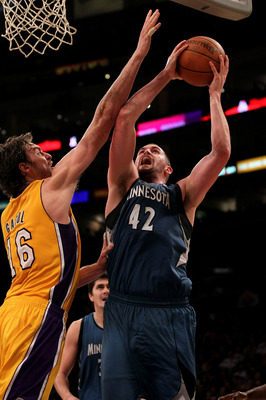 LOS ANGELES - NOVEMBER 9: Kevin Love #42 of the Minnesota Timberwolves shoots over Pau Gasol #16 of the Los Angeles Lakers at Staples Center on November 9, 2010 in Los Angeles, California. The Lakers won 99-94.   NOTE TO USER: User expressly acknowledges