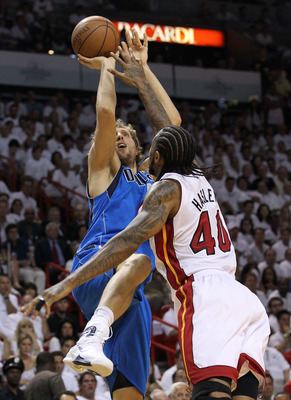 MIAMI, FL - JUNE 12:  Dirk Nowitzki #41 of the Dallas Mavericks attempts a shot against Udonis Haslem #40 of the Miami Heat in Game Six of the 2011 NBA Finals at American Airlines Arena on June 12, 2011 in Miami, Florida. NOTE TO USER: User expressly ackn
