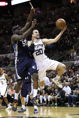 SAN ANTONIO, TX - APRIL 27:  Manu Ginobili #20 of the San Antionio Spurs shoots over Zach Randolph #50 of the Memphis Grizzlies in Game Five of the Western Conference Quarterfinals in the 2011 NBA Playoffs on April 27, 2011 at AT&T Center in San Antonio,