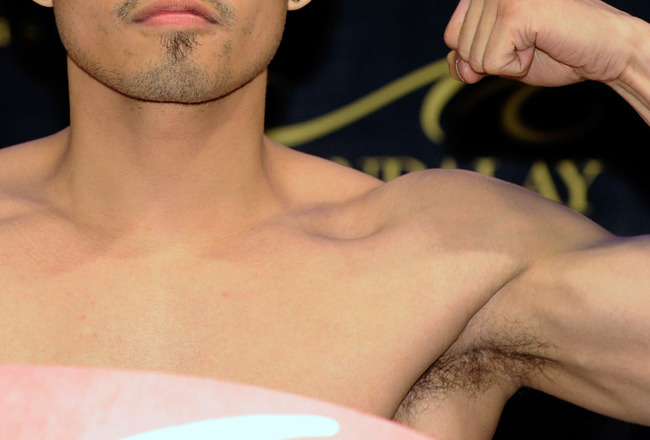 LAS VEGAS, NV - FEBRUARY 18:  Nonito Donaire of the Philippines poses on a scale during the official weigh-in for his fight against WBC/WBO bantamweight champion Fernando Montiel of Mexico at the Mandalay Bay Resort & Casino February 18, 2011 in Las Vegas