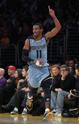 LOS ANGELES, CA - JANUARY 02:  Mike Conley #11 of the Memphis Grizzlies reacts after making a shot against the Los Angeles Lakers during the second half at Staples Center on January 2, 2011 in Los Angeles, California. The Grizzlies defeated the Lakers 104