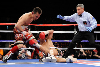 LAS VEGAS, NV - FEBRUARY 19:  (L-R) Nonito Donaire of the Philippines sends Fernando Montiel of Mexico to the canvas in the second round of their WBC/WBO bantamweight championship bout as referee Russell Mora moves in at the Mandalay Bay Events Center Feb