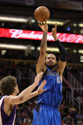 PHOENIX, AZ - FEBRUARY 17:  Tyson Chandler #6 of the Dallas Mavericks puts up a shot over Robin Lopez #15 of the Phoenix Suns during the NBA game at US Airways Center on February 17, 2011 in Phoenix, Arizona. The Mavericks defeated the Suns 112-106. NOTE
