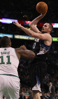 BOSTON, MA - JANUARY 03:  Kevin Love #42 of the Minnesota Timberwolves takes a shot as Glen Davis #11 of the Boston Celtics defends on January 3, 2011 at the TD Garden in Boston, Massachusetts. The Celtics defeated the Timberwolves 96-93. NOTE TO USER: Us